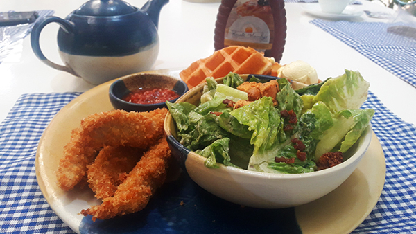 waffle, breaded chicken, and salad