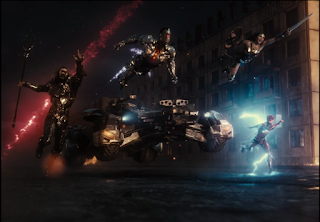 A shot of the Justice League charging into battle, where they freeze for a moment.