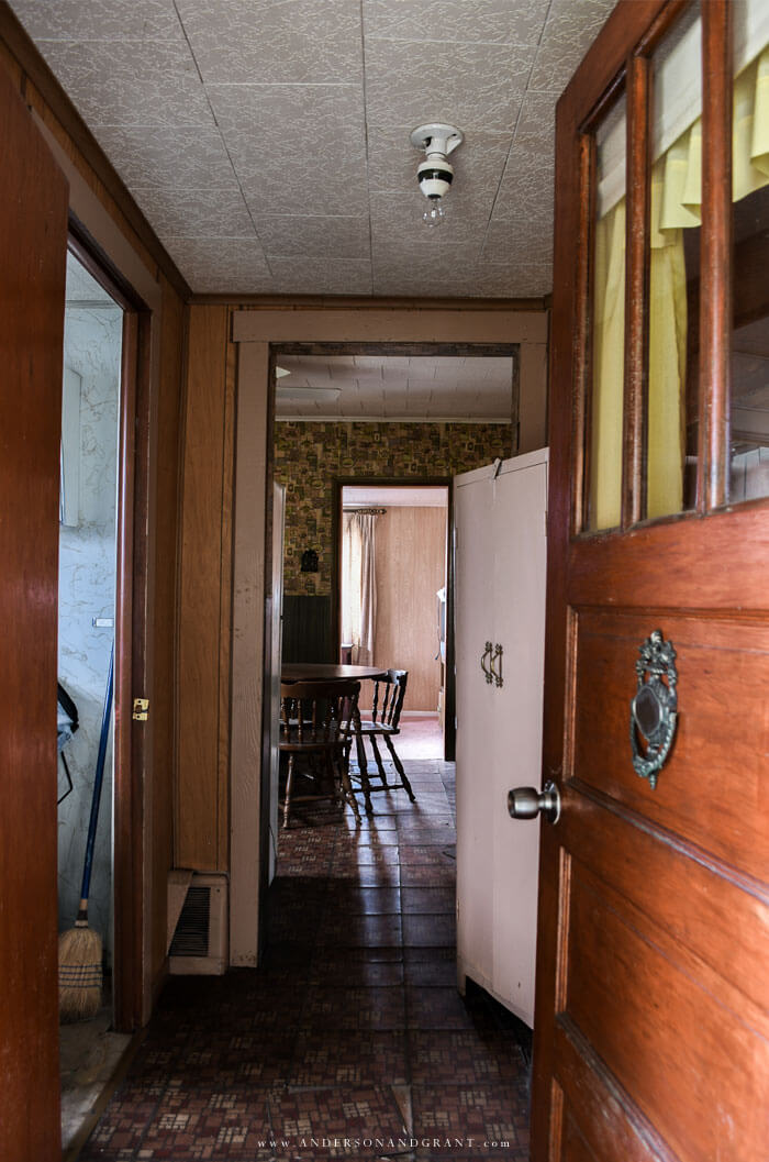 Inside the doorway of a dated fixer upper.