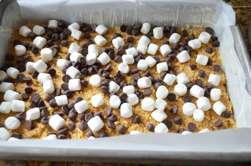 Mud Hen Bar dough covered with chocolate chips and marshmallows.
