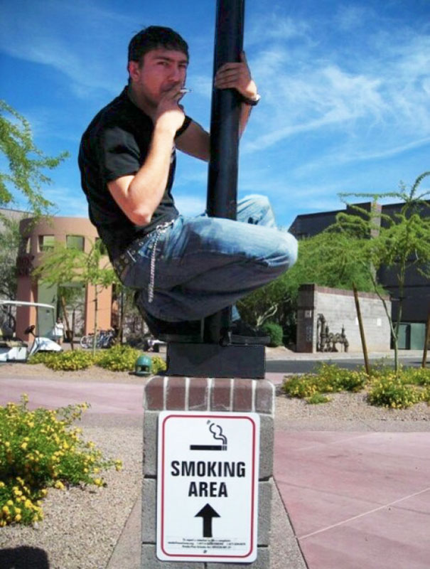 50 Hilarious Photos Of People Who Took Instructions Too Literally - Smoker With Good Climbing Skills