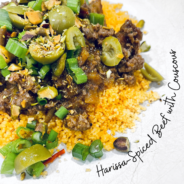 harissa-spiced beef over couscous in a bowl