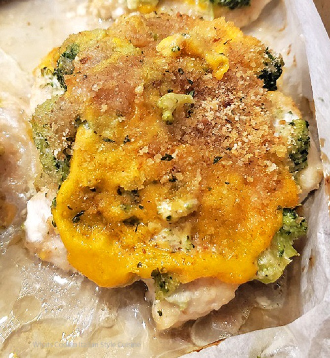 this is a baked boneless chicken breast topped with cheddar and broccoli