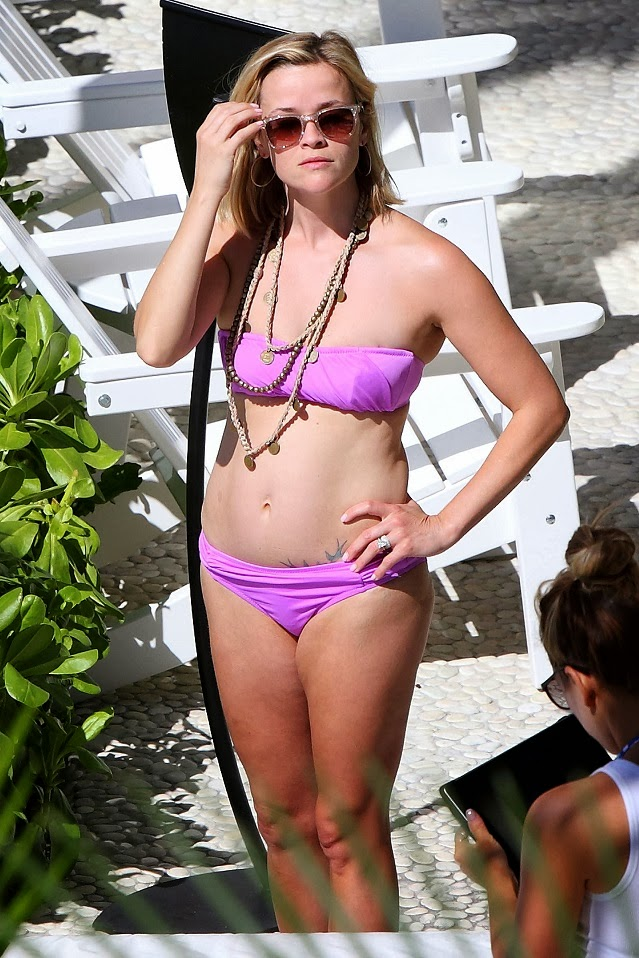 Reese Witherspoon in a purple bandeau bikini in Hawaii