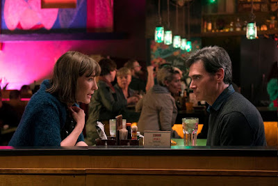 Cate Blanchett and Billy Crudup talk about Bernadette's problems over dinner in a restaurant in a movie still for Richard Linklater's drama Where'd You Go, Bernadette