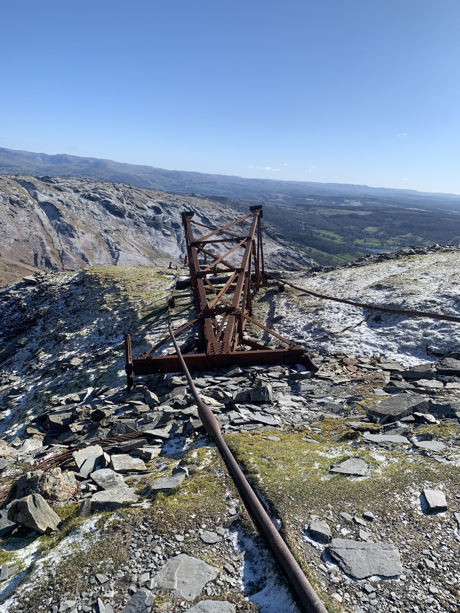 Abandoned electrical pylon that is now rusty on the hike up old man of coniston