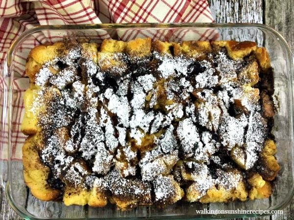 French Toast Breakfast Casserole baked and sprinkled with powdered sugar from Walking on Sunshine Recipes
