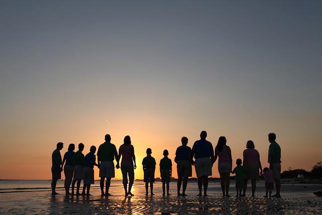 photograph of family walking on the beach near sanibel