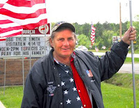 Larry Eckhardt is known as 'The Flagman'