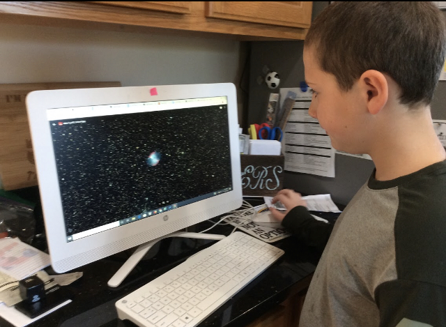 Plymouth South Elementary School Student, Aidan F., examines his image of M27, The Dumbbell Nebula, taken on Insight Observatory's 16 f/3.7 astrograph reflector (ATEO-1) remote telescope.