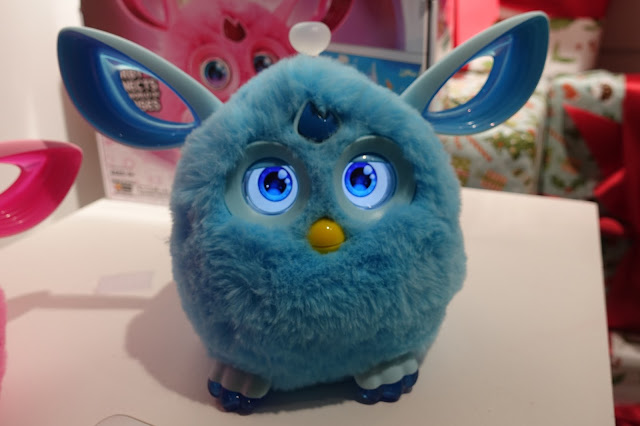 A blue furby connect with it's eyes open
