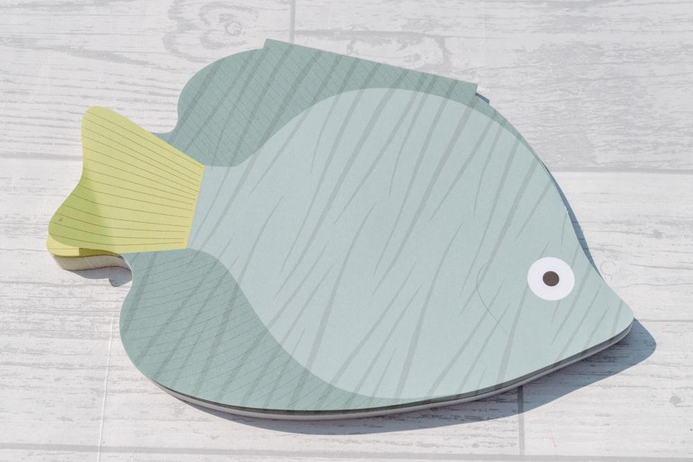 A fish shaped desk pad