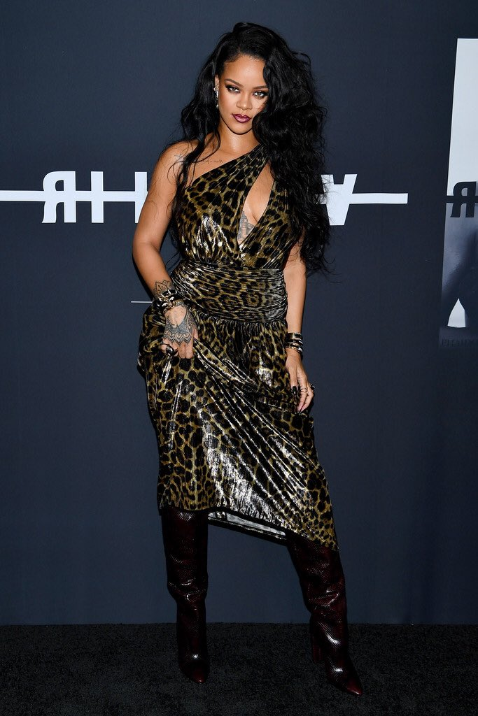 Rihanna shows off her wild side in a leopard print dress