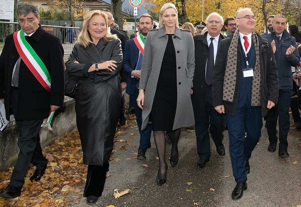 Princess Charlene wore Louis Vuitton wool cashmere grey coat with black Jimmy Choo pumps. Italian and Monegasque Red Cross