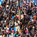 A group of 300 sub-Saharan Africans sit in board a boat