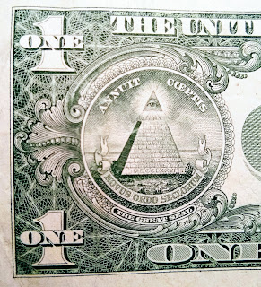 Partial image of a United States one-dollar bill. Photo by K. R. Smith.