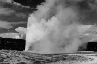 Cramer Imaging's black and white landscape photograph of Old Faithful geyser at Yellowstone National Park, Wyoming
