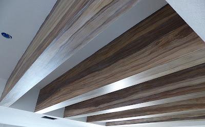 five ceiling beams faux painted to look like wood