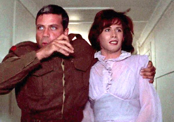 Brian Deacon femulating in the 1972 UK film The Triple Echo.