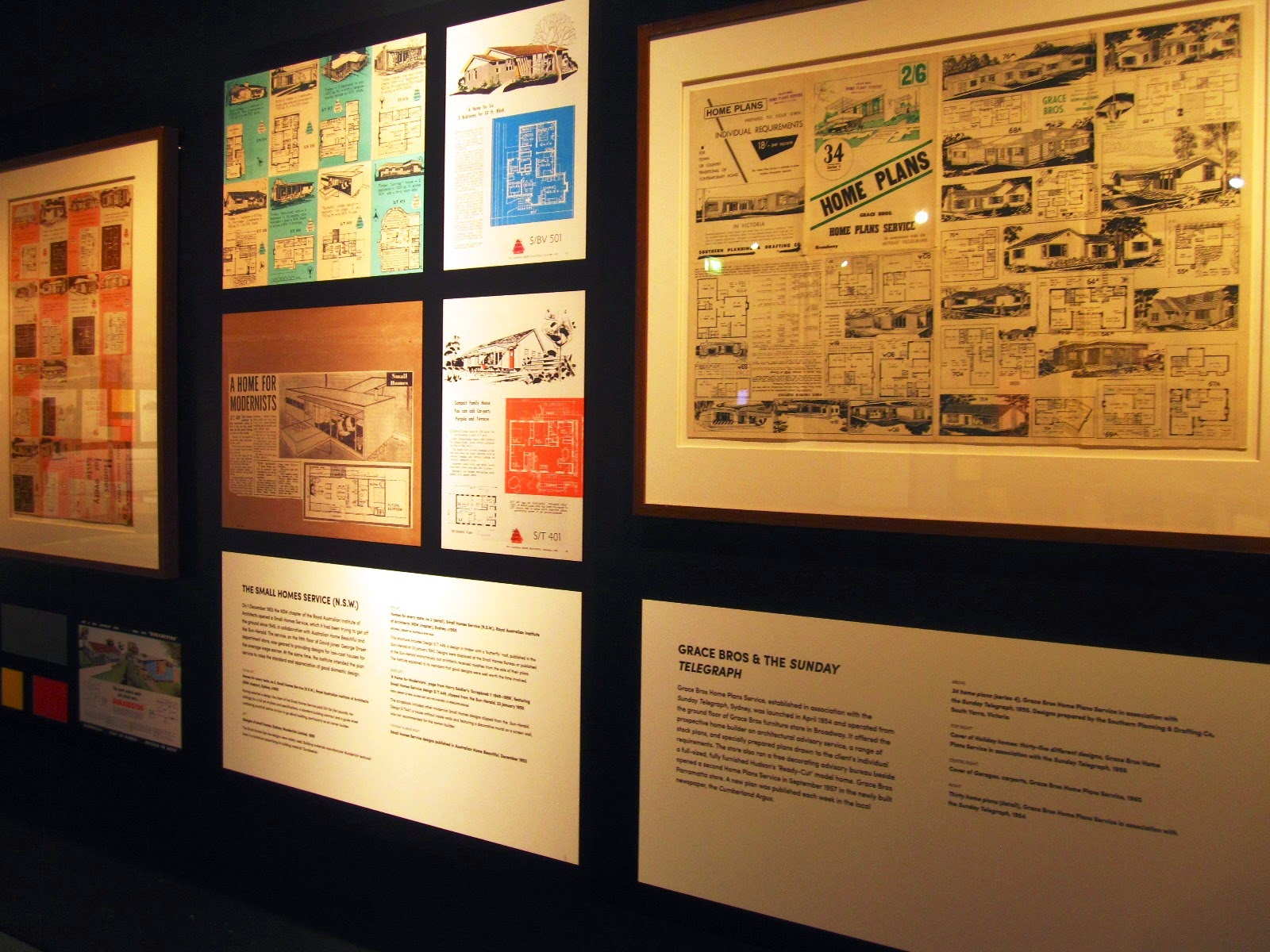 View of vintage plans and magazine articles in the exhibition 'Dream Home Small Home'.