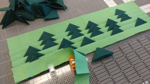 Adding prairie points to make trees in a quilt block