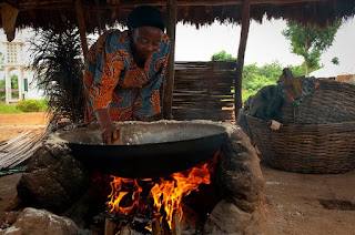 Mynebre in Tanzania cooking over an open fire with her favorite cooking pot