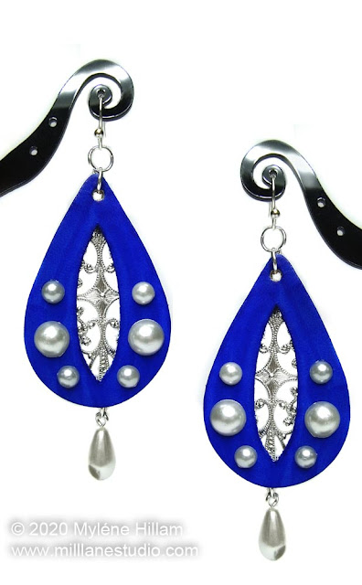Ultramarine blue leather teardrop earrings with cut out for filigree and imitation pearl detailing.