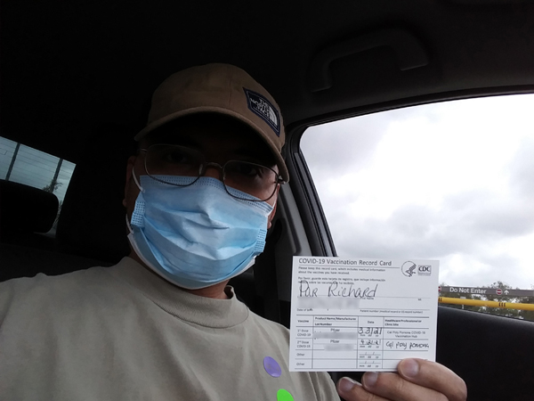 Posing with my COVID-19 vaccination record card after I got my second dose of the Pfizer-BioNTech vaccine...on April 21, 2021.