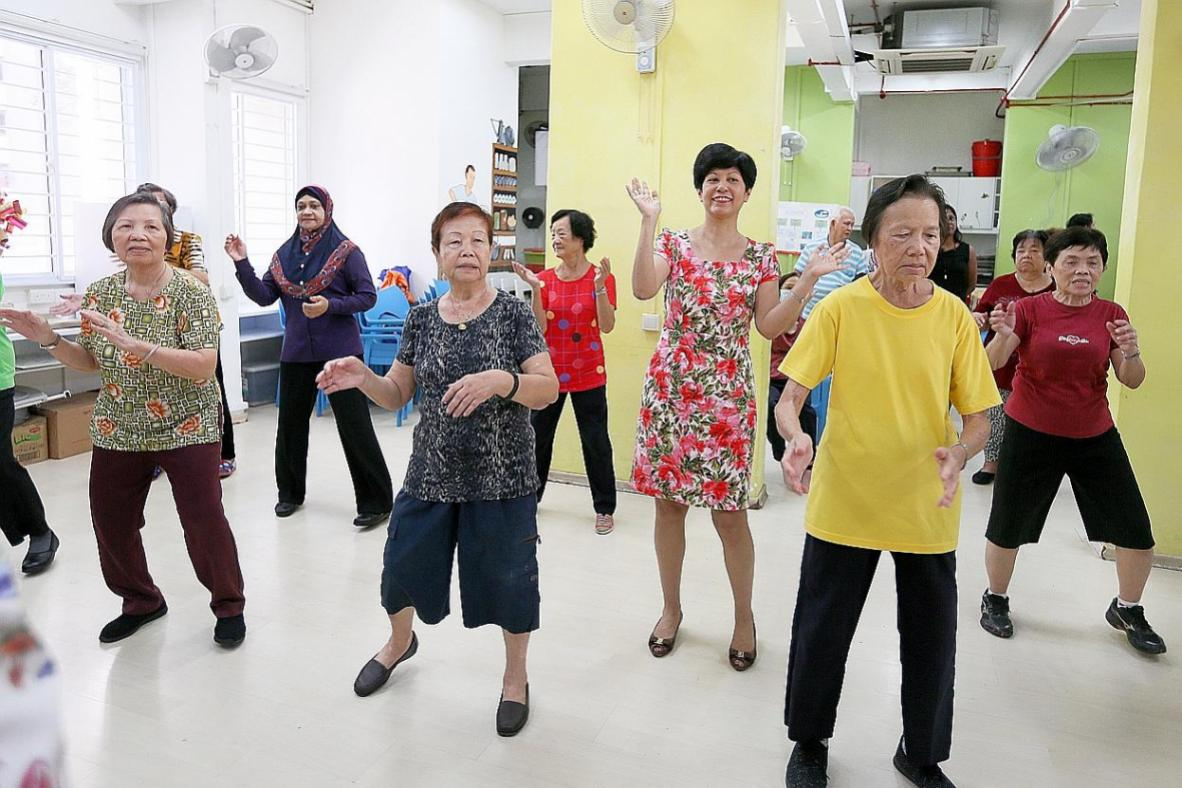 Senior Minister of State for Finance and Law Indranee Rajah (centre) doing the line dance with seniors at AWWA Dementia Day Care Centre.