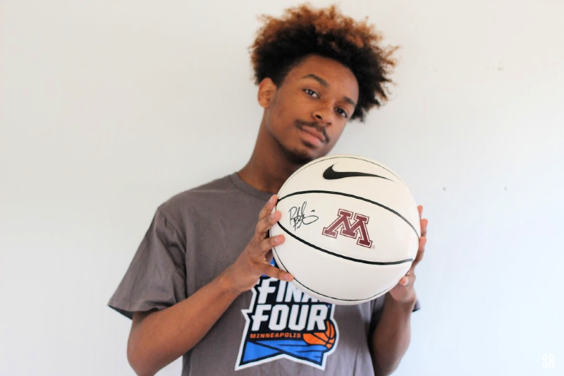 teen in Final Four shirt holding basketball