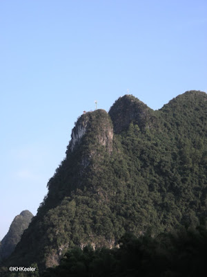 Karst hill with cel phone tower, China