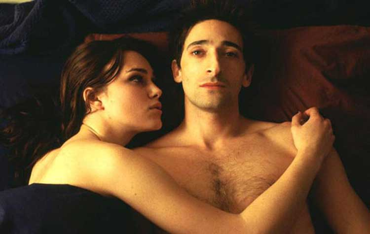 Keira Knightley and Adrien Brody lay in bed in The Jacket.