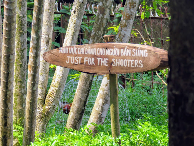 Sign promoting the shooting range at the Cu Chi Tunnels outside Ho Chi Minh City in Vietnam