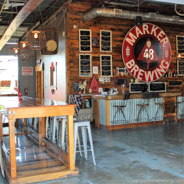Marker 48 Brewing taproom with a bar and wooden tables