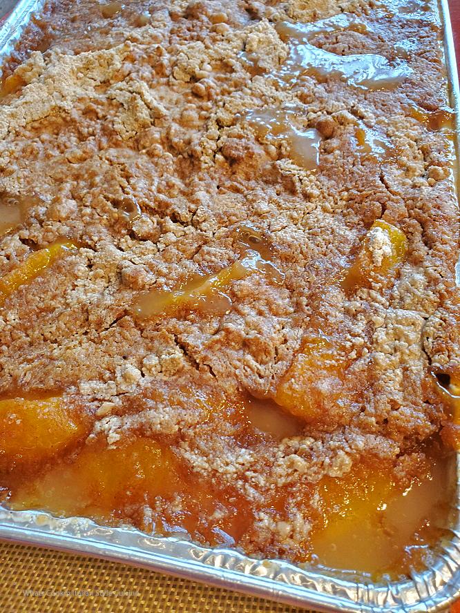 this is a sheet pan of peach cobbler dump cake