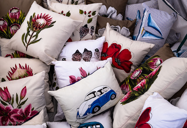 Vibrant and comfy hand painted pillows with boats, cars and flowers
