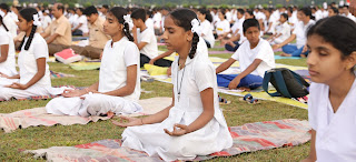 Visually challenged students of Ranga Rao Memorial School for Disabled and employees of Cycle Pure Agarbathies at International Yoga Day