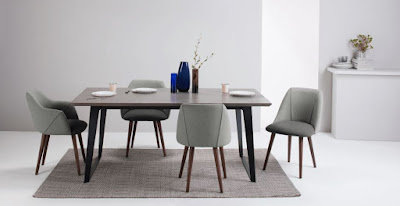 Comfortable gray dining room with retro dining chairs