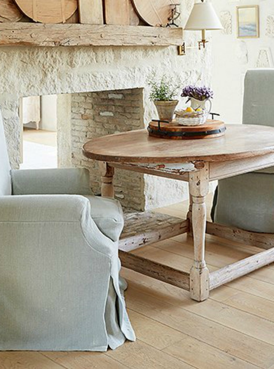 Detail of white oak flooring, limestone fireplace, and rustic antique dining table in a #farmhousekitchen by #BrookeGiannetti for #PatinaFarm
