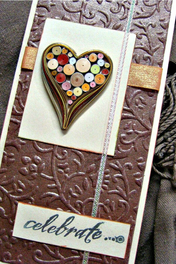handmade card with quilled heart filled with rolled paper tight coils