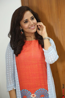 Actress Anasuya Bharadwaj in Orange Short Dress Glam Pics at Winner Movie Press Meet February 2017 (59).JPG