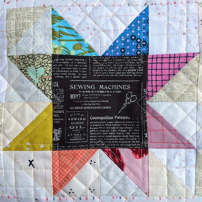patchwork star with rainbow coloured points quilted