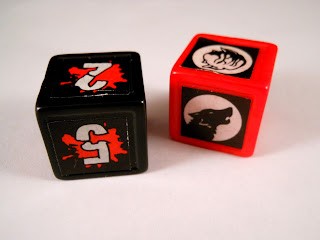 The custom dice from Goosebumps Terror in the Graveyard board game.