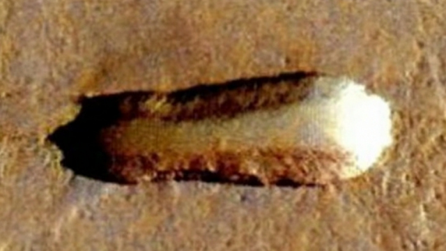 This UFO on Mars is over a mile long and it's shape is to uniform and regular to be natural.