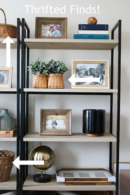 Open shelves styled with thrifted finds