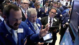 Dow posts record close as Fed meeting starts, Trump talks to the UN