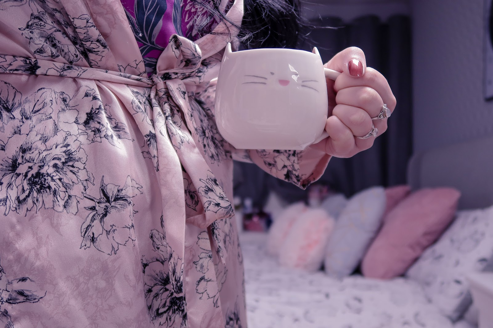 Close up photo of Jordanne from The Life of a Glasgow Girl holding a white cat mug in a pink satin robe