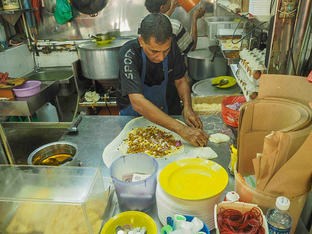 Man making murtabak at Tekka Centre hawker centre, Singapore