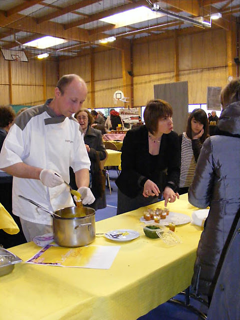 Restaurateurs handing out samples at a food festival, Indre et Loire, France. Photo by Loire Valley Time Travel.