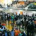 Policías hacen largas filas para cobrar salarios con cheques este sábado